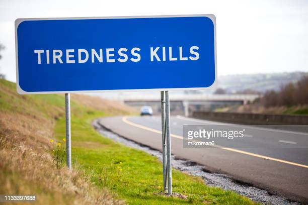 tiredness kills sign - road sign stock pictures, royalty-free photos & images