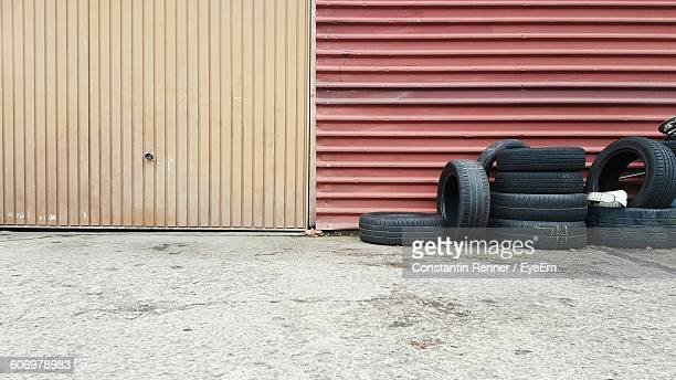 Tires Against Metallic Wall
