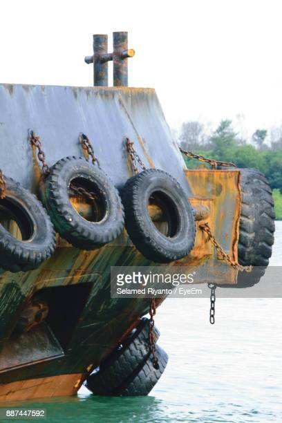 Tires Hanging On Nautical Vessel On River