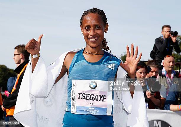 Tirfi Tsegaye of Ethiopia celebrates after crossing the finish line to win in the women's category of the 41th BMW Berlin Marathon on September 28...