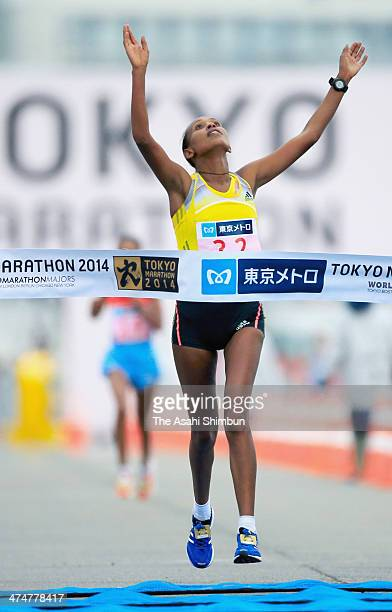 Tirfi Tsegaye of Ethiopia crosses the finishing line to win during the Tokyo Marathon 2014 on February 23 2014 in Tokyo Japan