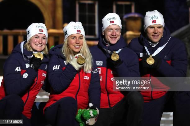 Tiril Eckhoff, Marte Olsbu Roeiseland, Johannes Thingnes Boe and Vetle Sjaastad Christiansen of Norway celebrate winning the gold medal at the medal...