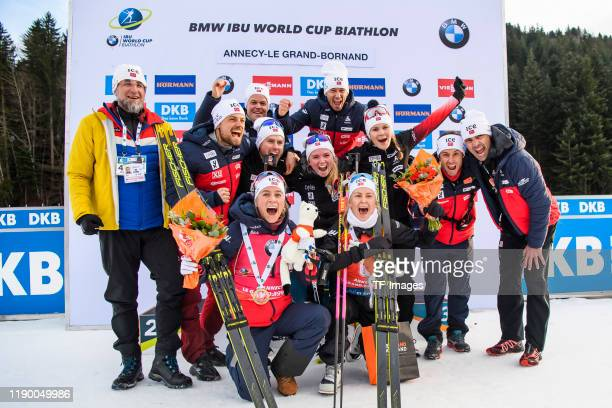 Tiril Eckhoff of Norway and Ingrid Landmark Tandrevold of Norway with the team after the medal ceremony during the Women 10 km Pursuit Competition at...