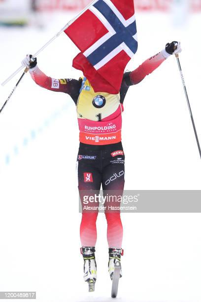 Tiril Eckhoff of Norway jumps over the finish line in celebration of winning the Women 10 km Pursuit Competition at the BMW IBU World Cup Biathlon...