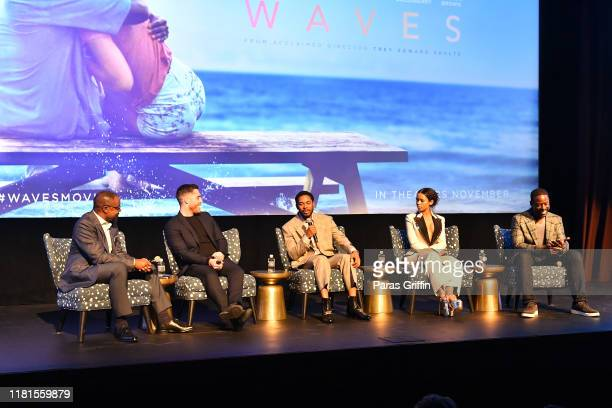 Tirrell D Whittley Trey Edward Shults Kelvin Harrison Jr Taylor Russell and Sterling K Brown onstage during the Waves Atlanta red carpet premiere at...