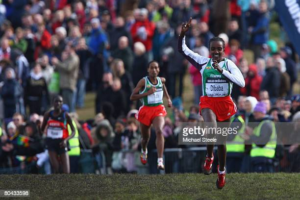 Tirunesh Dibaba of Ethiopia celebrates victory in the women's elite race during the 36th IAAF World Cross Country Championships at Holyrood Park on...