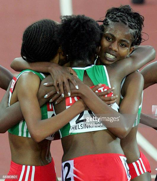 Tirunesh Dibaba of Ethiopia celebrates with her teammates after she won the women's 5000 metres final at the 10th IAAF World Athletics Championships...
