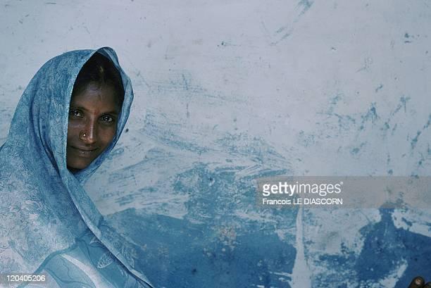 Tirupati India Woman in blue sari in front of blue wall