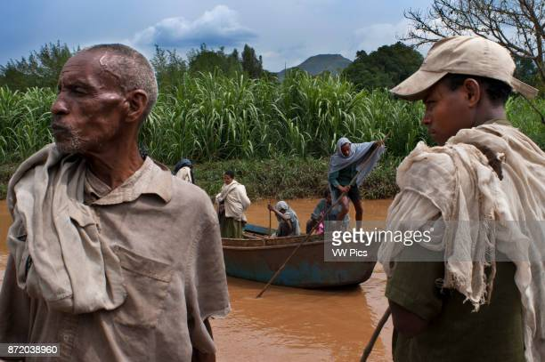 Tis Isat or Blue Nile waterfalls Bahar Dar Ethiopia Africa Local people go by boat on the Abay River next to the Blue Nile Falls The Blue Nile Falls...