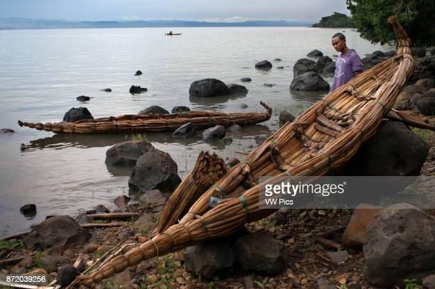 Tis Isat or Blue Nile waterfalls Bahar Dar Ethiopia Africa Papyrus canopies next to Papyrus Canoe next to Lake Tana In Woito the famous canoes of...