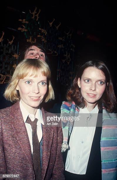 Tisa Farrow with her sister Mia Farrow. Mia is wearing a red tweed jacket; circa 1970; New York.