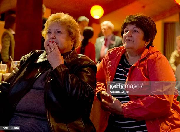 Tisei supporters Alicia Persia left of Lynn Mass and Lorraine Carmichael of Peabody Mass watch the election results at the Kowloon Restaurant on...
