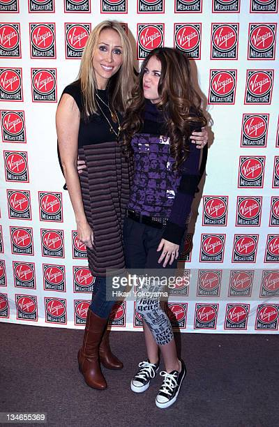 Tish Cyrus and Miley Cyrus during Miley Cyrus Signing for Hannah Montana Soundtrack at Virgin Records Megastore in Times Square - October 24, 2006 at...