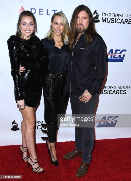 Tish Cyrus Billy Ray Cyrus Miley Cyrus arrives at the 2019 MusiCares Person Of The Year Honoring Dolly Parton at Los Angeles Convention Center on...