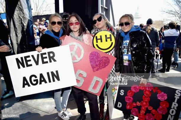 Tish Cyrus Noah Cyrus Miley Cyrus and Brandi Glenn Cyrus attend March For Our Lives on March 24 2018 in Washington DC