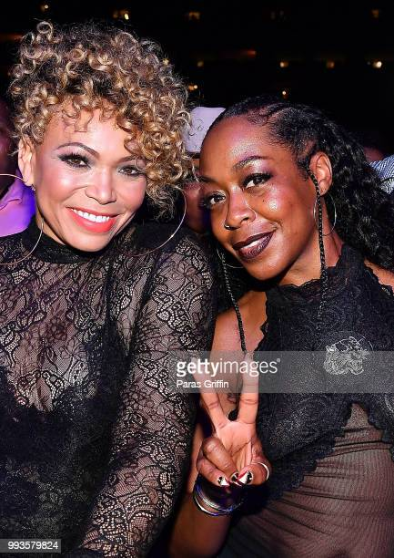 Tisha CampbellMartin and Tichina Arnold attend the 2018 Essence Festival Night 2 at Louisiana Superdome on July 7 2018 in New Orleans Louisiana