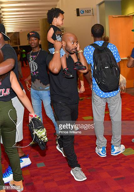 Titan Witherspoon and Tim Witherspoon attend the 13th annual Bike Show at Georgia World Congress Center on July 16 2016 in Atlanta Georgia