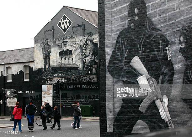 A Titanic related mural is pictured near a Loyalist paramilitary mural in Belfast Northern Ireland on March 13 2012 The world's biggest Titanic...