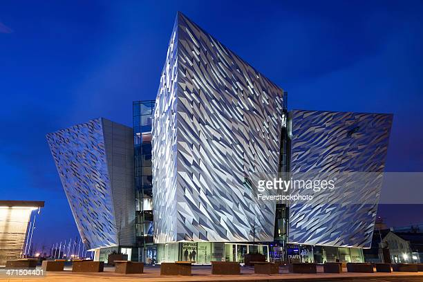 titanic visitor centre building in belfast northern ireland - belfast stock pictures, royalty-free photos & images