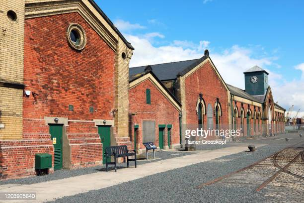 titanic's dock and pump house in the titanic quarter in belfast - rainer grosskopf stock pictures, royalty-free photos & images