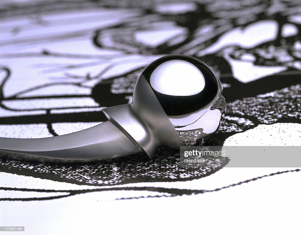 Titanium hip replacement laying on a decorative table cover : Stock Photo