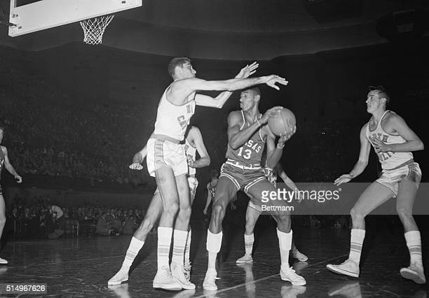 Titans Battle Kansas City Kans All American Lennie Rosenbluth of North Carolina sets up a block on AllAmerican Wilt Chamberlain of Kansas during the...