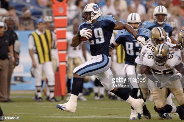 Titans Chris Brown breaks a tackle during first half action between The Tennessee Titans and the New Orleans Saints at The Coliseum in Nashville,...