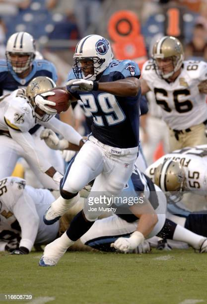 Titans Chris Brown runs with the ball during first half action between The Tennessee Titans and the New Orleans Saints at The Coliseum in Nashville,...