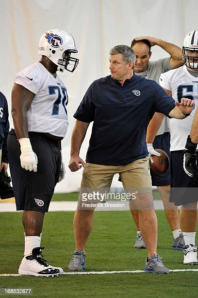 Titans first round pick Chance Warmack gets coached by Titans head coach Mike Munchak at the Tennessee Titans rookie camp on May 10 2013 in Nashville...