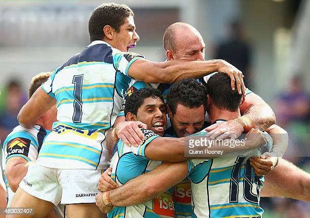 Titans players celebrate a try by Mark Minichiello during the round five NRL match between the Melbourne Storm and the Gold Coast Titans at AAMI Park...