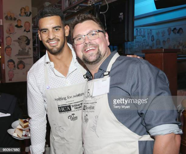 Titans quarterback Marcus Mariota and GAC HOST Storme Warren wait tables during the 17th annual Waiting for Wishes celebrity dinner at The Palm on...