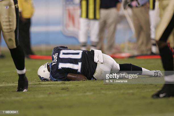 Titans quarterback Vince Young lays on the field after twisting his ankle during action between the New Orleans Saints and the Tennessee Titans at LP...