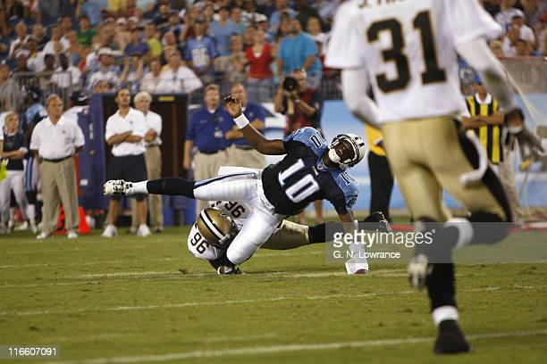 Titans quarterback Vince Young twists his ankle as he is tackled during action between the New Orleans Saints and the Tennessee Titans at LP Field in...