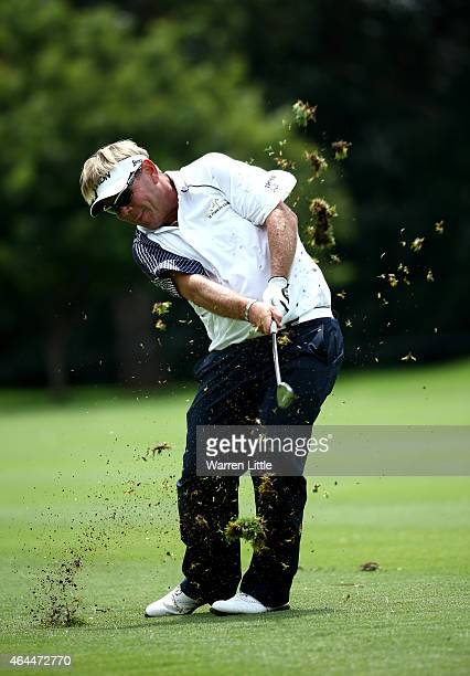 Titch Moore of South Africa plays his second shot into the 17th green during the first round of the Joburg Open at Royal Johannesburg and Kensington...