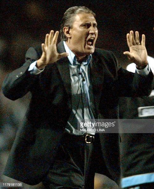 Tite Bachi coach of the Gremio celebrates his teams goal against the Olimpia team 17 July 2002 at the Olympic Stadium in Porto Alegre Brazil AFP...