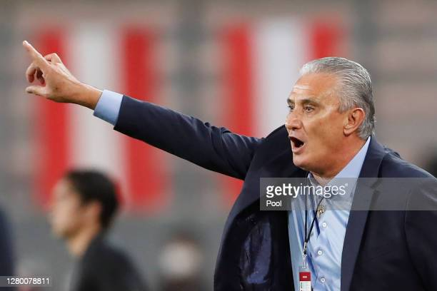 Tite coach of Brazil gives instructions during a match between Peru and Brazil as part of South American Qualifiers for Qatar 2022 at Estadio...