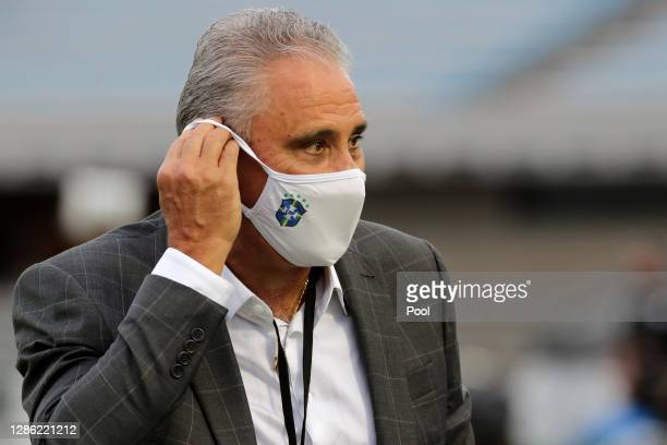 Tite head coach of Brazil adjusts his protective mask before a match between Uruguay and Brazil as part of South American Qualifiers for World Cup...
