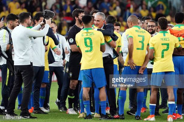 Tite head coach of Brazil and Brazil players celebrate after winning during the Copa America Brazil 2019 Final match between Brazil and Winner SF2 at...