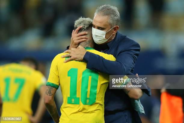 Tite head coach of Brazil comforts Neymar Jr. Of Brazil after the final of Copa America Brazil 2021 between Brazil and Argentina at Maracana Stadium...