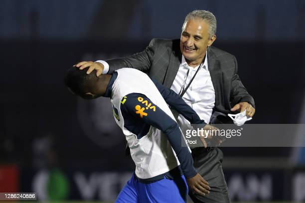 Tite head coach of Brazil congratulates Vinicius Junior of Brazil after a match between Uruguay and Brazil as part of South American Qualifiers for...