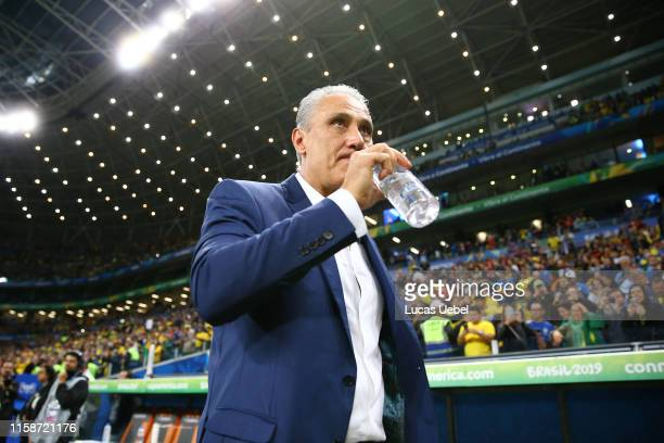 Tite head coach of Brazil drinks water during the Copa America Brazil 2019 quarterfinal match between Brazil and Paraguay at Arena do Gremio on June...