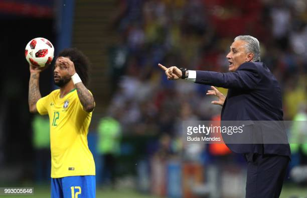 Tite Head coach of Brazil gives his team instructions as Marcelo of Brazil holds the ball during the 2018 FIFA World Cup Russia Quarter Final match...