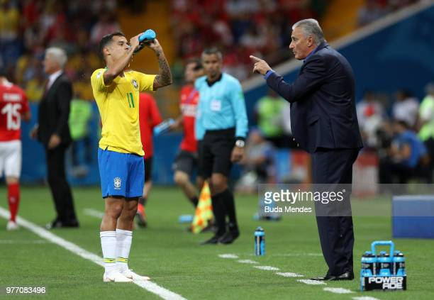 Tite Head coach of Brazil gives instructions to Philippe Coutinho of Brazil during the 2018 FIFA World Cup Russia group E match between Brazil and...