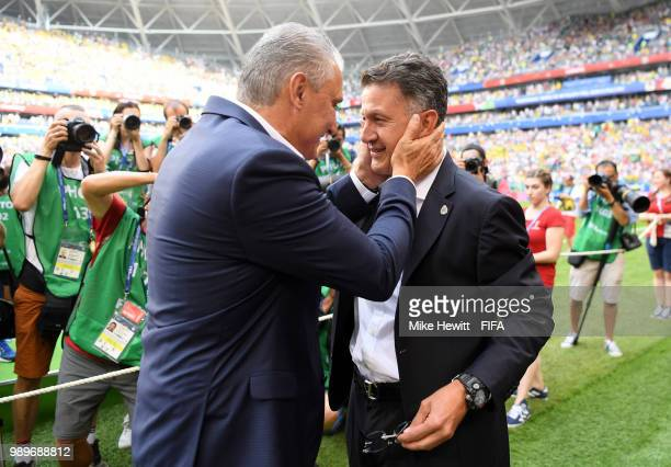 Tite Head coach of Brazil greets Juan Carlos Osorio Manager of Mexico prior to the 2018 FIFA World Cup Russia Round of 16 match between Brazil and...