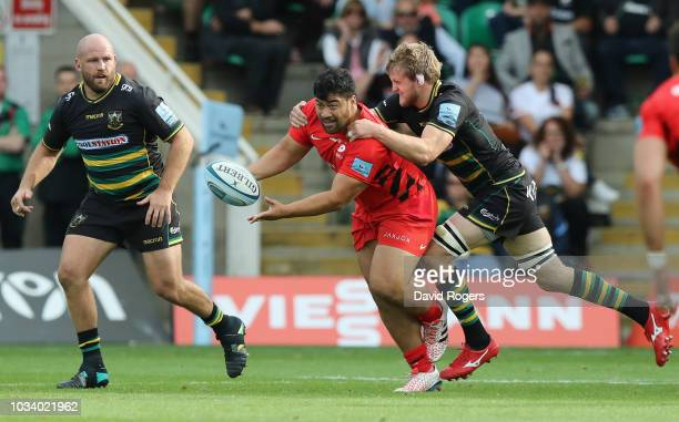 Titi Lamositele of Saracens off loads the ball during the Gallagher Premiership Rugby match between Northampton Saints and Saracens at Franklin's...