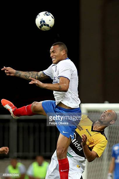Titi of Bahia heads the ball clear during the match between Bahia and Criciuma as part of Brasileirao Series A 2014 at Arena Fonte Nova on August 20...