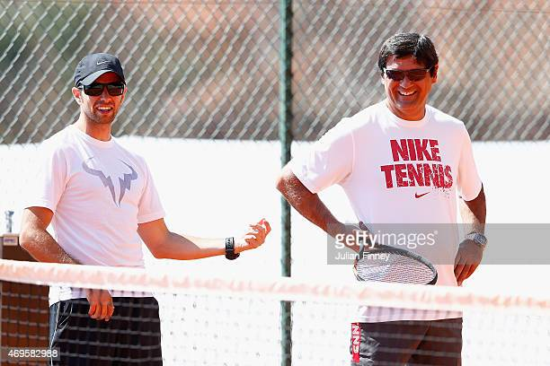 Titin Maymo and coach Toni Nadal share a joke as Rafael Nadal of Spain is in a practice session during day two of the Monte Carlo Rolex Masters...