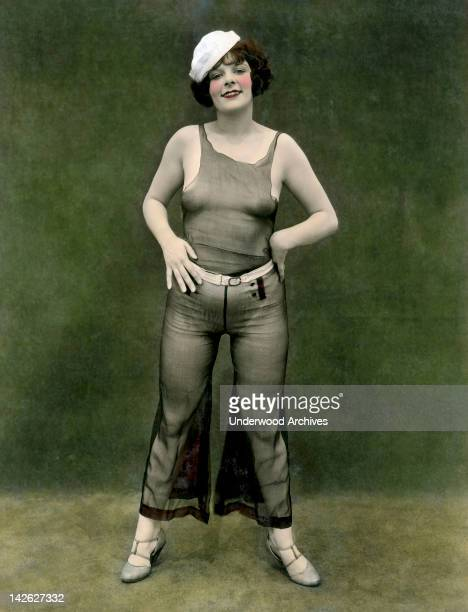 Titled 'A Little Salt' this pinup woman in a sheer outfit and a sailor cap looks the part 1930