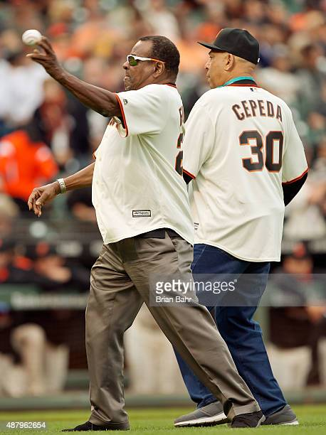 Tito Fuentes and Orlando Cepeda of the San Francisco Giants throw out the ceremonial first pitch before a game against the San Dieigo Padres at ATT...