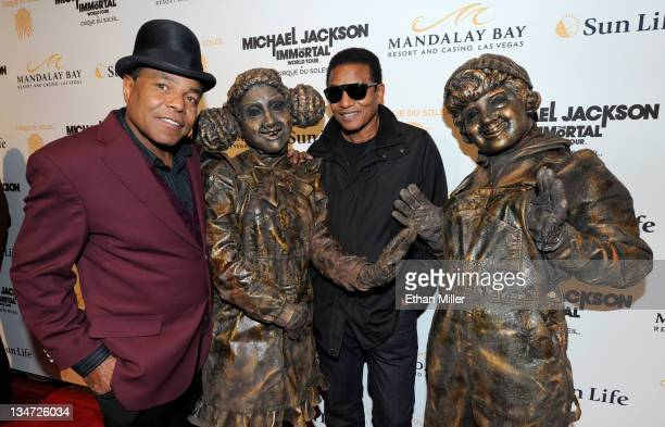 Tito Jackson and Jackie Jackson pose with Cirque du Soleil performers as they arrive at the Las Vegas premiere of Michael Jackson THE IMMORTAL World...